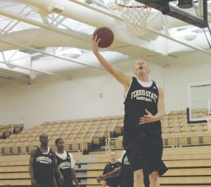 Reach for the Sky: Senior Austin Randel polishes up his slam dunk style at practice. The season opening game took place this Sunday in Illinois, ending with a close 65-60 loss to the Lewis Flyers.  Photo By: Kate Dupon | Photographer