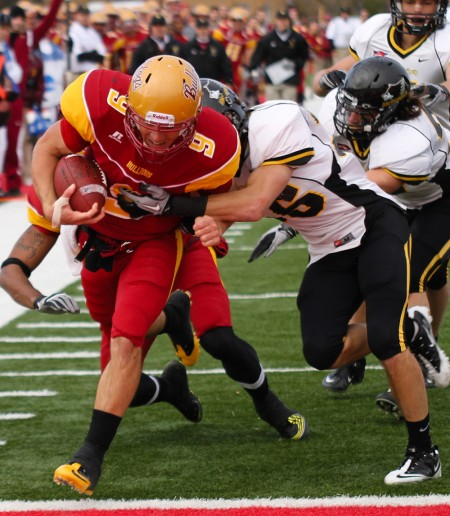 Falling Short: Tom Schneider, Ferris quarterback, steps into the end zone during Saturday's game against Michigan Tech. The Bulldogs fell short with a final score of 16-28. Photo By: Brock Copus | Photographer