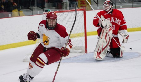 Sending Miami Home: Sophomore forward Kyle Bonis, below, lines up a shot and celebrates a goal against the No. 1 nationally-ranked Miami (Ohio) RedHawks, above. Ferris State defeated Miami Friday and Saturday games. The Bulldog victories improve the Bulldogs' 2010-11 season record to 5-3-2 overall and 2-2-2-2 in conference play. Photos By: Brock Copus|Photographer