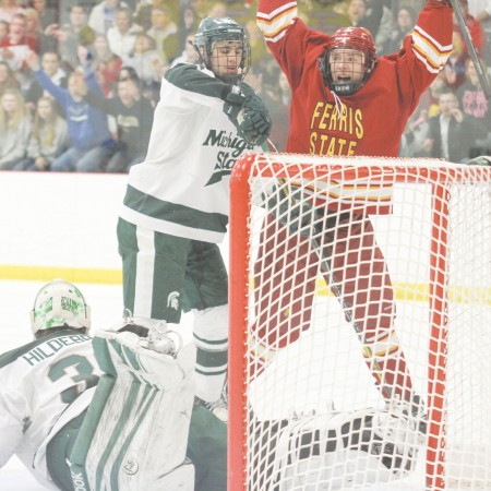 I'll Huff and I'll Puff and Score: Ferris State junior right wing Andy Huff celebrates the fourth goal of the game against Michigan State. The Bulldogs swept the Spartans for a home-and-home series. Photo By: Brock Copus | Multimedia Editor
