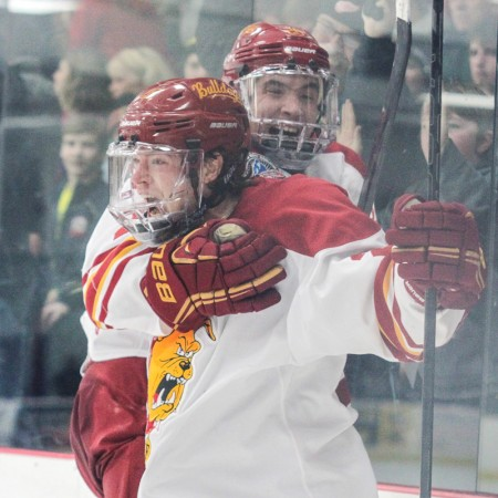 State of Elation: Ferris State captain Kyle Bonis screams in excitement while Simon Denis hops on his back after scoring the game-tying goal with less than a minute remaining in regulation.  Photo by Brock Copus | Multimedia Editor